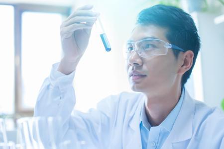 man using a testing tube